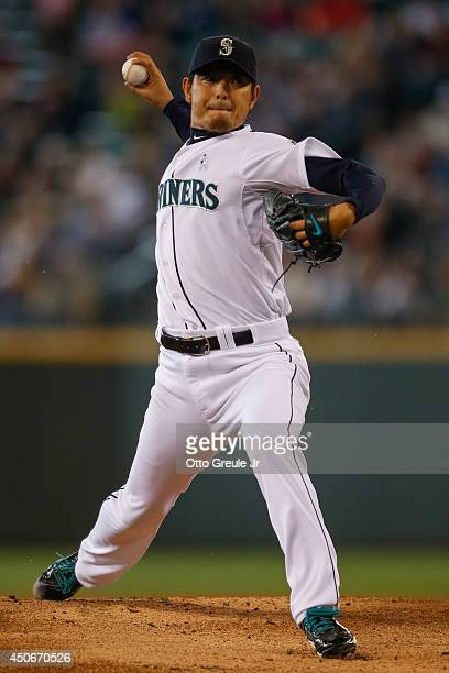 Starting pitcher Hisashi Iwakuma of the Seattle Mariners pitches in the first inning against the Texas Rangers at Safeco Field on June 15 2014 in...