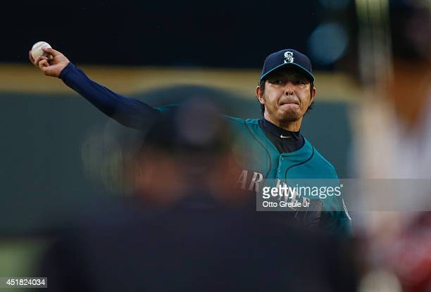 Starting pitcher Hisashi Iwakuma of the Seattle Mariners pitches in the fourth inning against the Minnesota Twins at Safeco Field on July 7, 2014 in...