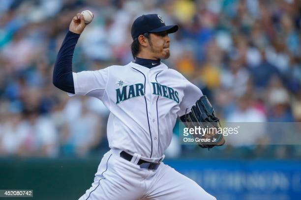 Starting pitcher Hisashi Iwakuma of the Seattle Mariners pitches in the first inning against the Oakland Athletics at Safeco Field on July 12 2014 in...