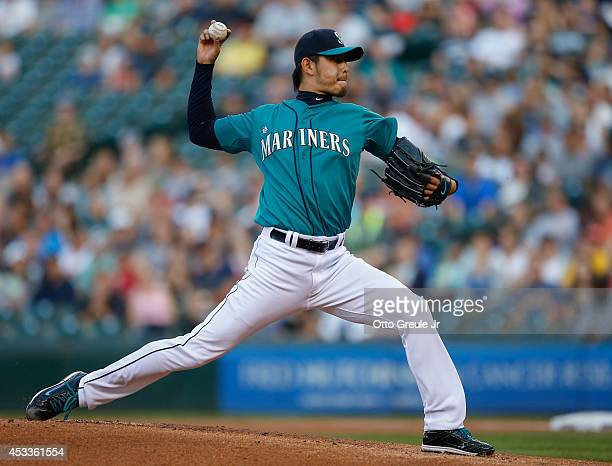Starting pitcher Hisashi Iwakuma of the Seattle Mariners pitches in the first inning against the Chicago White Sox at Safeco Field on August 8, 2014...