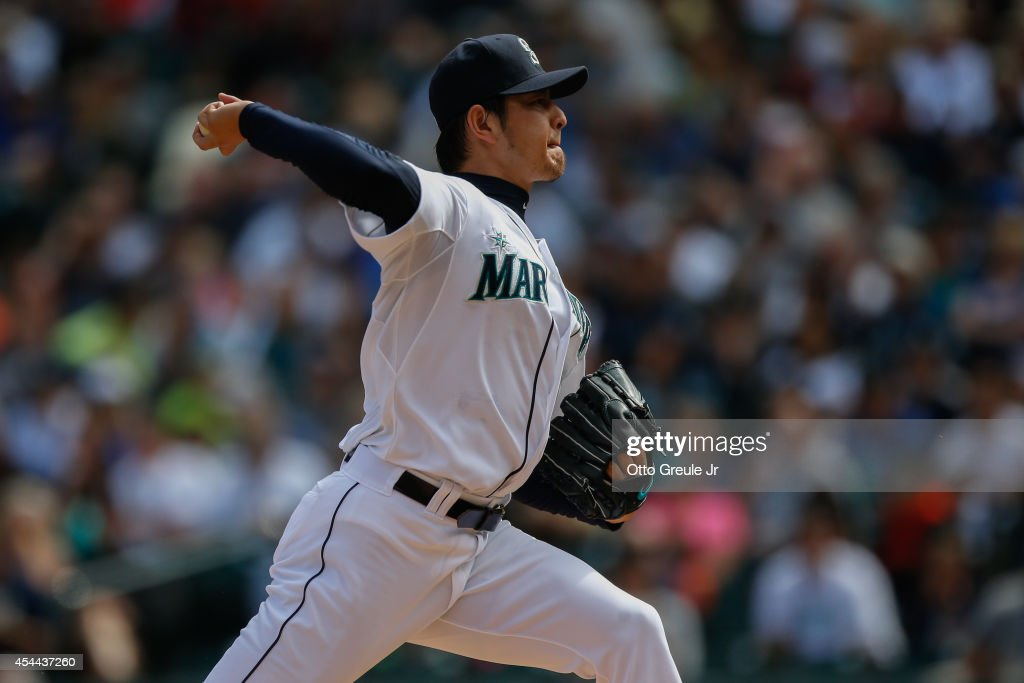 Starting pitcher Hisashi Iwakuma #18 of the Seattle Mariners pitches in the first inning against the Washington Nationals at Safeco Field on August 31, 2014 in Seattle, Washington.