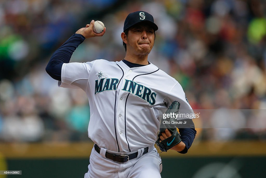 Starting pitcher Hisashi Iwakuma #18 of the Seattle Mariners pitches in the third inning against the Washington Nationals at Safeco Field on August 31, 2014 in Seattle, Washington. The Mariners defeated the Nationals 5-3.