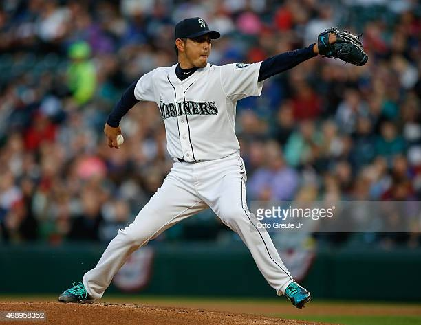 Starting pitcher Hisashi Iwakuma of the Seattle Mariners pitches in the first inning against the Los Angeles Angels of Anaheim at Safeco Field on...