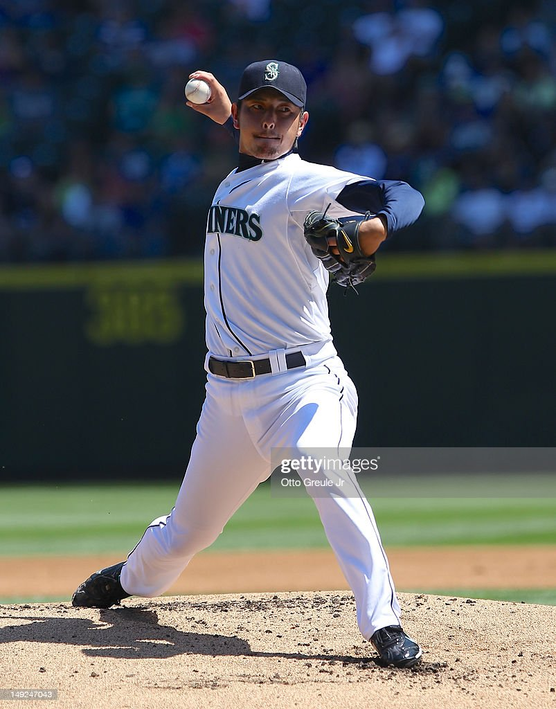 Starting pitcher Hisashi Iwakuma #18 of the Seattle Mariners pitches against the New York Yankees at Safeco Field on July 25, 2012 in Seattle, Washington. The Yankees defeated the Mariners 5-2.
