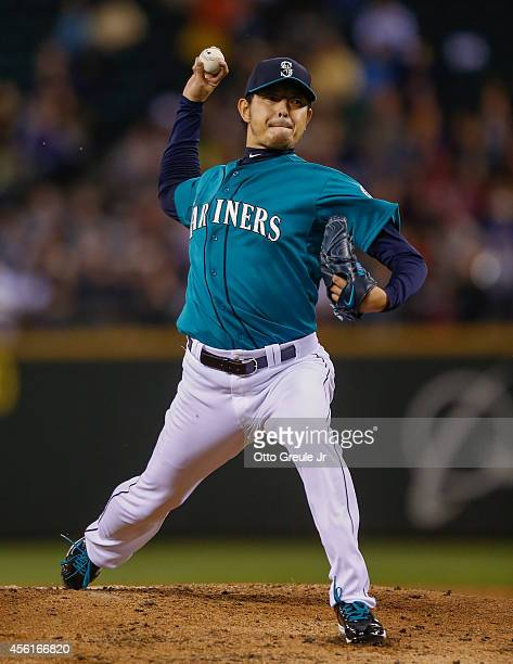 Starting pitcher Hisashi Iwakuma of the Seattle Mariners pitches against the Los Angeles Angels of Anaheim in the second inning at Safeco Field on...