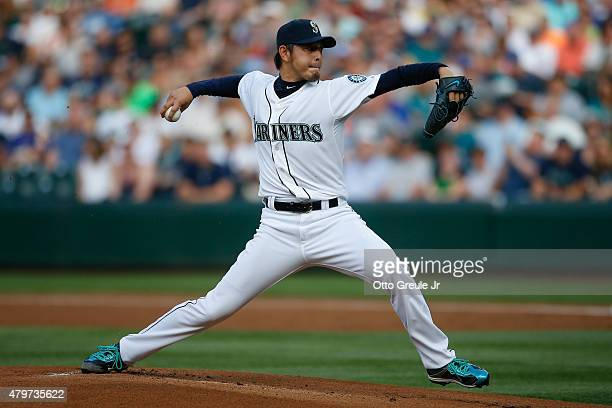 Starting pitcher Hisashi Iwakuma of the Seattle Mariners pitches against the Detroit Tigers in the first inning at Safeco Field on July 6 2015 in...