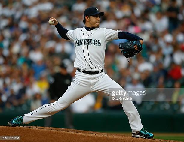 Starting pitcher Hisashi Iwakuma of the Seattle Mariners pitches against the Oakland Athletics in the first inning at Safeco Field on August 24 2015...
