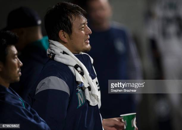 Starting pitcher Hisashi Iwakuma of the Seattle Mariners stands in the dugout during a game against the Los Angeles Angels of Anaheim at Safeco Field...