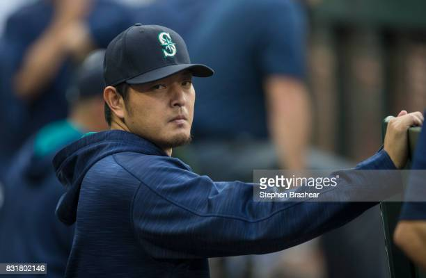 Starting pitcher Hisashi Iwakuma of the Seattle Mariners stands in the dugout before a game against the Los Angeles Angels of Anaheim at Safeco Field...