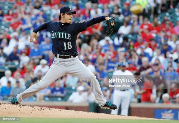 Starting pitcher Hisashi Iwakuma of the Seattle Mariners throws during the first inning of a baseball game against the Texas Rangers at Globe Life...