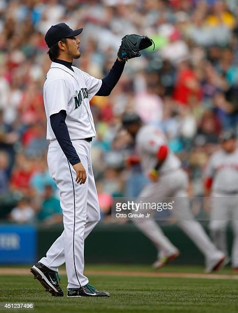 Starting pitcher Hisashi Iwakuma of the Seattle Mariners waits for a new ball after giving up a tworun homer to David Ortiz of the Boston Red Sox in...