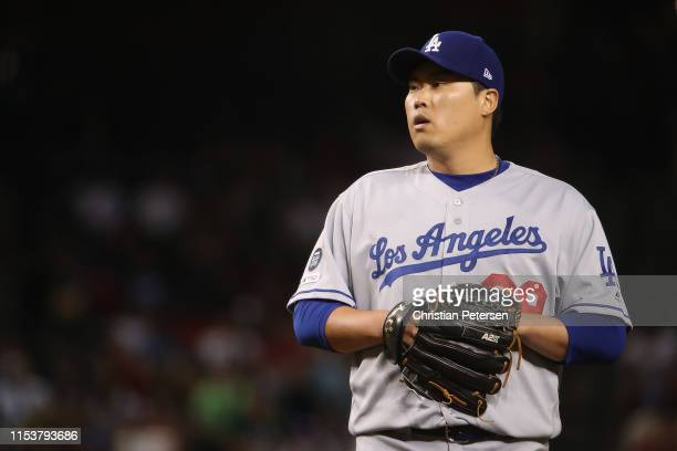 Starting pitcher HyunJin Ryu of the Los Angeles Dodgers prepares to throw a pitch during the seventh inning of the MLB game against the Arizona...