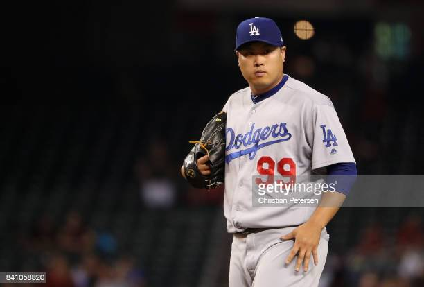 Starting pitcher HyunJin Ryu of the Los Angeles Dodgers reacts on the mound during the first inning of the MLB game against the Arizona Diamondbacks...
