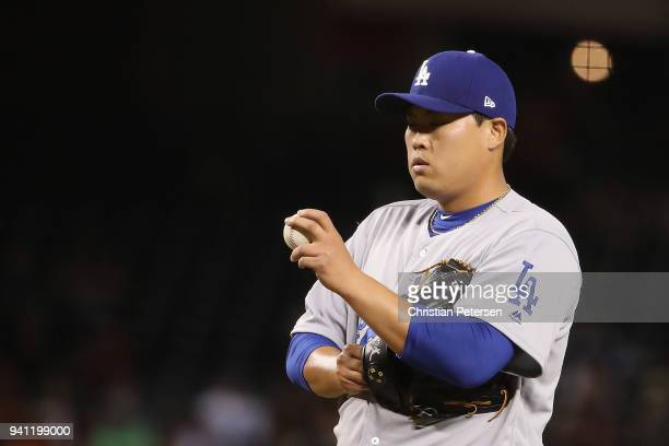 Starting pitcher HyunJin Ryu of the Los Angeles Dodgers reacts on the mound during the third inning of the MLB game at Chase Field on April 2 2018 in...