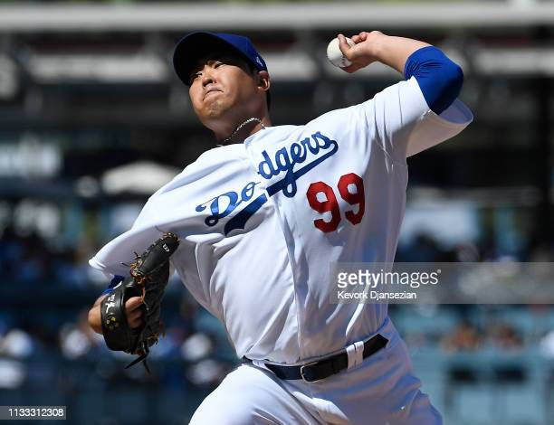 Starting pitcher HyunJin Ryu of the Los Angeles Dodgers throws against the Arizona Diamondbacks during the third inning at Dodger Stadium on March 28...