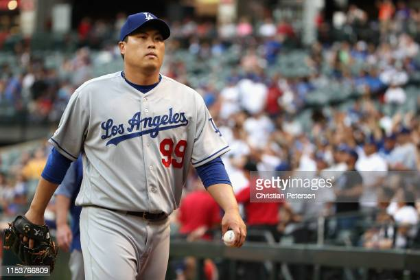 Starting pitcher HyunJin Ryu of the Los Angeles Dodgers walks to the dugout before the MLB game against the Arizona Diamondbacks at Chase Field on...