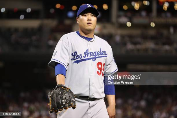 Starting pitcher HyunJin Ryu of the Los Angeles Dodgers walks to the dugout during the seventh inning of the MLB game against the Arizona...