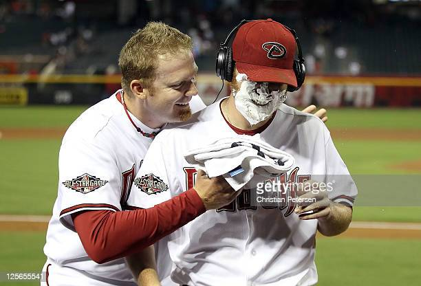 Starting pitcher Ian Kennedy of the Arizona Diamondbacks receives a shaving cream salute from JJ Putz after defeating the Pittsburgh Pirates in the...