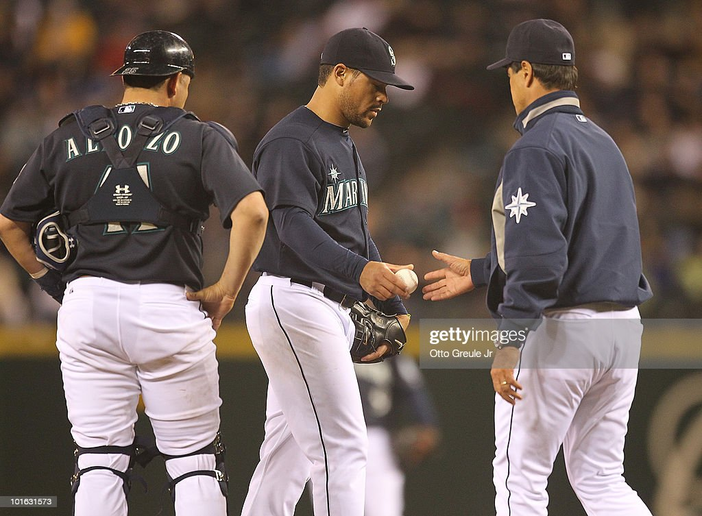 Starting pitcher Ian Snell #35 of the Seattle Mariners is removed from the game by manager Don Wakamatsu #22 as catcher Eliezer Alfonzo #41 looks on against the Los Angeles Angels of Anaheim at Safeco Field on June 4, 2010 in Seattle, Washington.