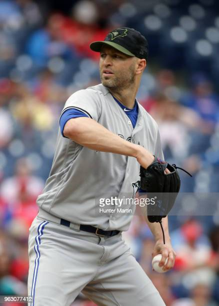 Starting pitcher JA Happ of the Toronto Blue Jays throws a pitch in the first inning during a game against the Philadelphia Phillies at Citizens Bank...