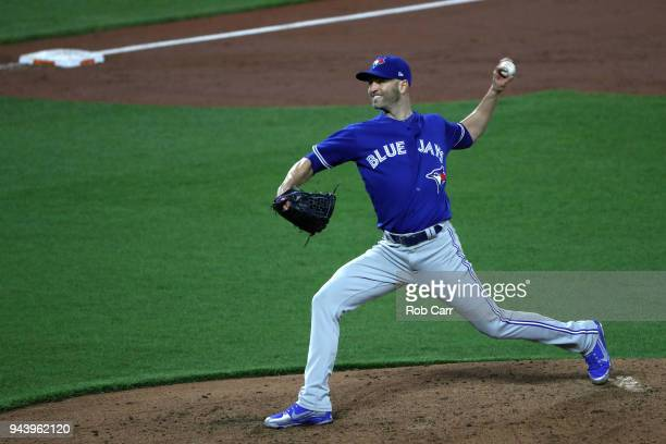 Starting pitcher JA Happ of the Toronto Blue Jays throws to a Baltimore Orioles batter in the third inning at Oriole Park at Camden Yards on April 9...