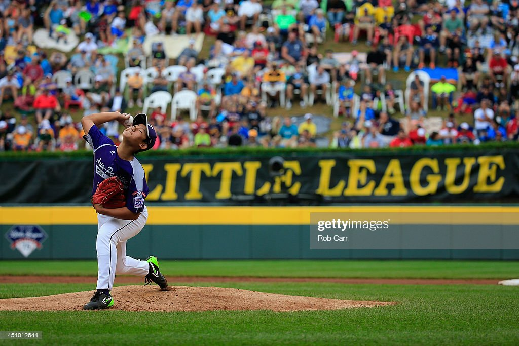 Starting pitcher Jae Yeong Hwang #18 of Team Asia-Pacific throws to a Team Japan batter during the first inning of the International Championship game of the Little League World Series at Lamade Stadium on August 23, 2014 in South Williamsport, Pennsylvania.