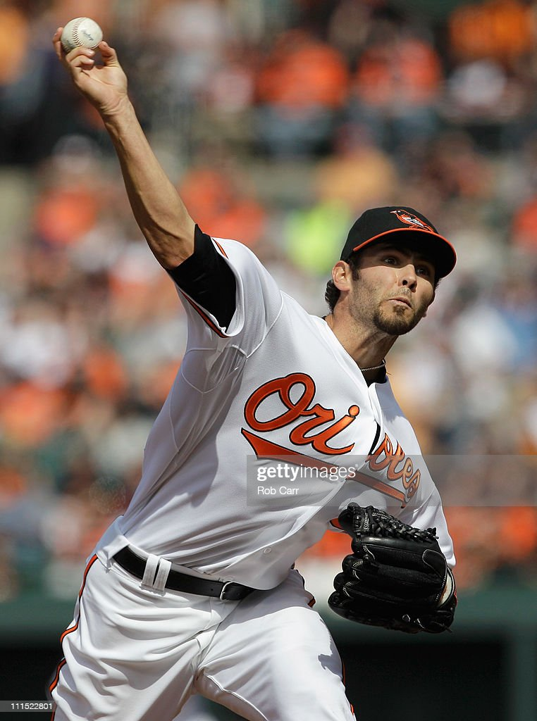 Starting pitcher Jake Arrieta #34 of the Baltimore Orioles delivers to a Detroit Tigers batter during the second inning during opening day at Oriole Park at Camden Yards on April 4, 2011 in Baltimore, Maryland.
