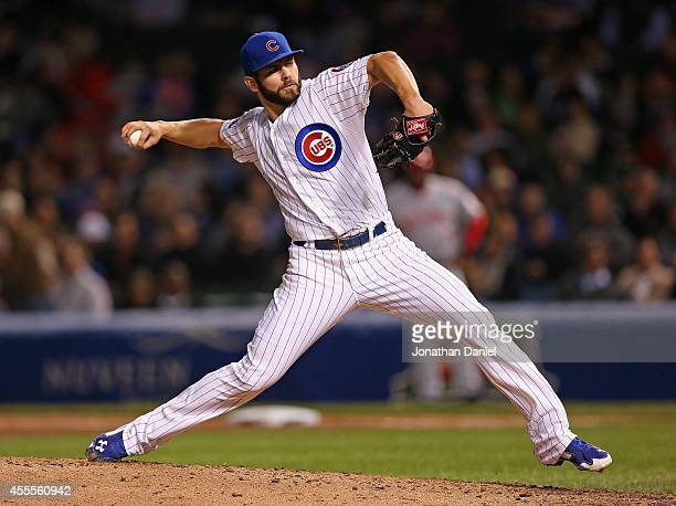 Starting pitcher Jake Arrieta of the Chicago Cubs delivers the ball against the Cincinnati Reds at Wrigley Field on September 16 2014 in Chicago...