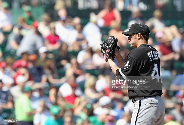 Starting pitcher Jake Peavy of the Chicago White Sox pitches against the Los Angeles Angels of Anaheim during the MLB spring training game at Tempe...