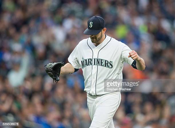 Starting pitcher James Paxton of the Seattle Mariners reacts as he walks off the field after getting a strikeout during the fifth inning of a game...