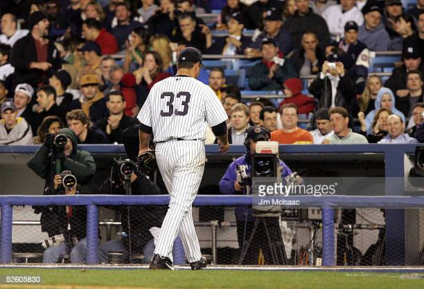 Starting pitcher Jaret Wright of the New York Yankees walks off the field after manager Joe Torre makes a pitching change in the fifth inning against...
