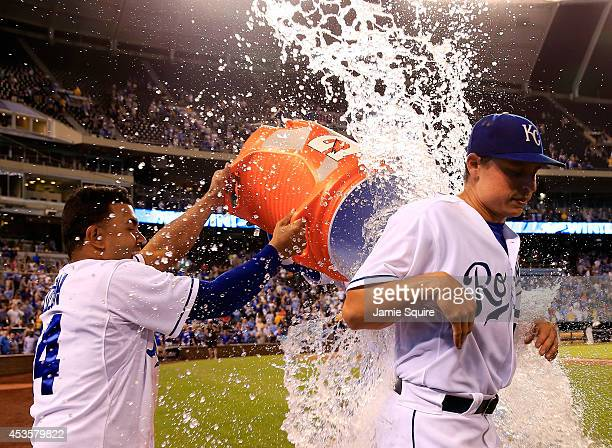 Starting pitcher Jason Vargas of the Kansas City Royals receives a water dunk from Christian Colon and Salvador Perez after pitching a complete game...