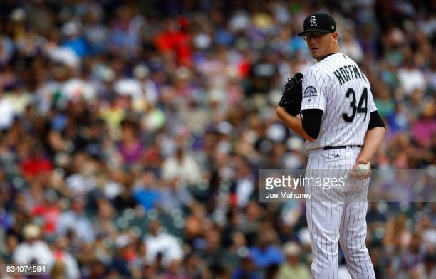 Starting pitcher Jeff Hoffman of the Colorado Rockies looks toward first base in the fourth inning at Coors Field on August 17 2017 in Denver...