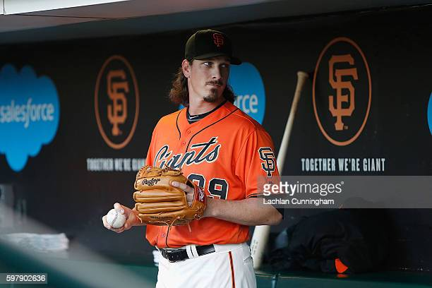 Starting pitcher Jeff Samardzija of the San Francisco Giants looks on in the dugout before the game against the Atlanta Braves at ATT Park on August...