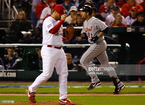 Starting pitcher Jeff Suppan of the St Louis Cardinals reacts after giving up a solo home run to Sean Casey of the Detroit Tigers in the second...