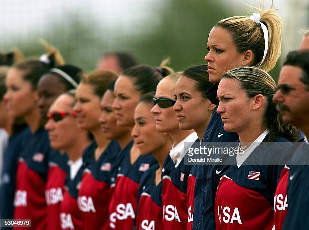 Starting pitcher Jennie Finch of Team USA looks on with her teammates as the starting lineups are announced during the International Sports...