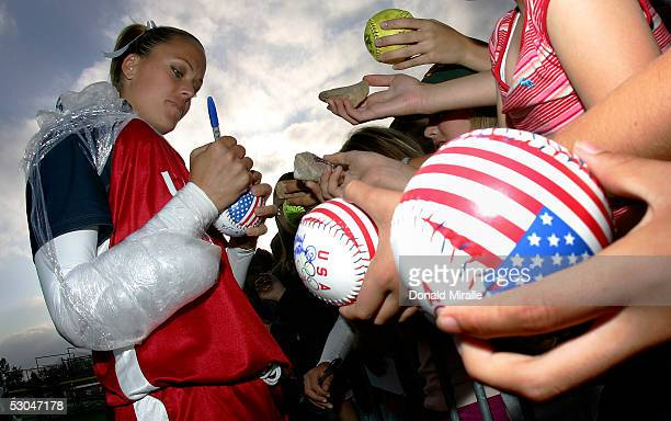 Starting pitcher Jennie Finch of Team USA signs autographs for fans after the International Sports Invitational Women's Softball game against Canada...