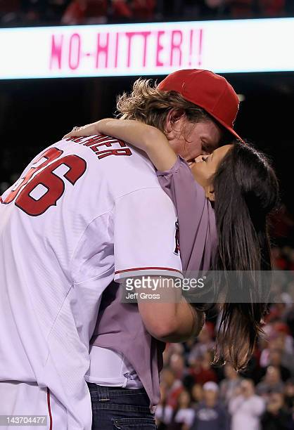 Starting pitcher Jered Weaver of the Los Angeles Angels of Anaheim receives a kiss from his wife Kristin after throwing a nohitter against the...