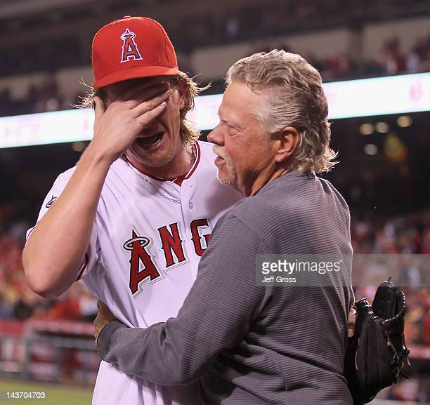 Starting pitcher Jered Weaver of the Los Angeles Angels of Anaheim celebrates with his dad Dave after throwing a nohitter against the Minnesota Twins...