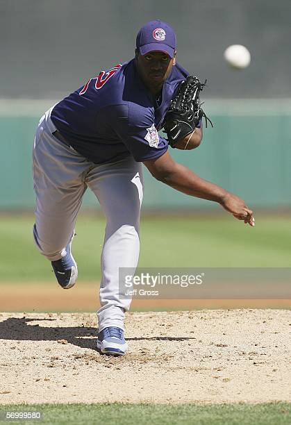 Starting pitcher Jerome Williams of the Chicago Cubs throws a warm up pitch during a Spring Training game against the San Francisco Giants at...