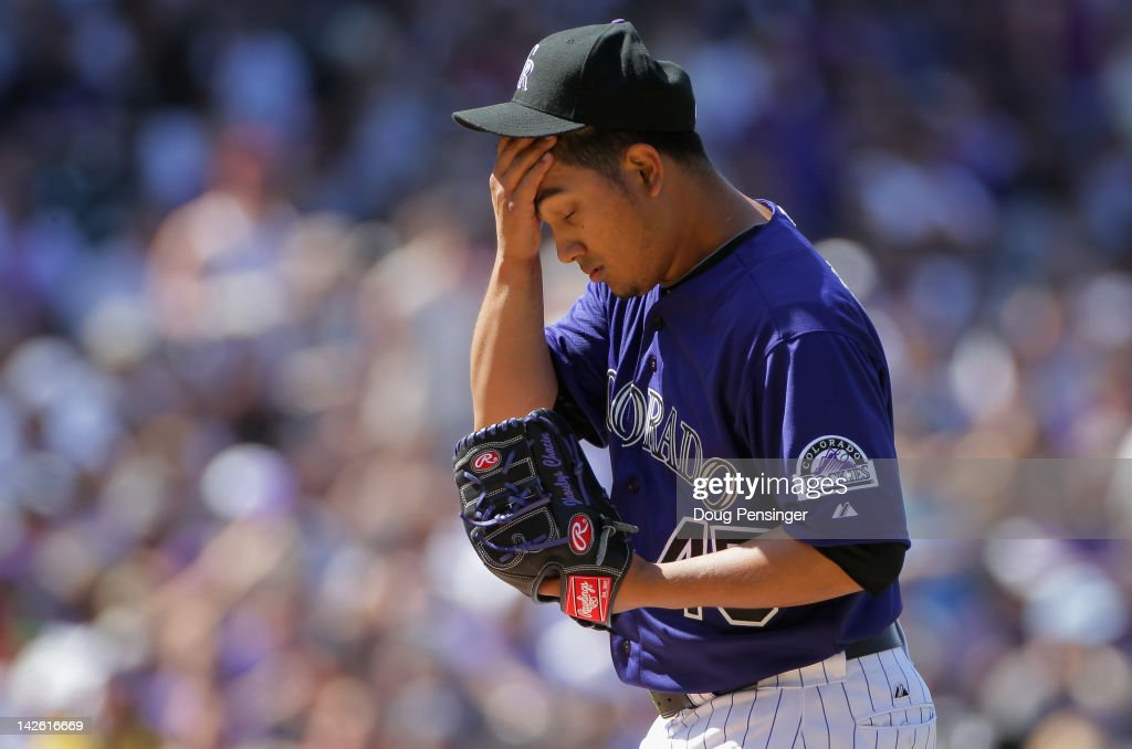 Starting pitcher Jhoulys Chacin #45 of the Colorado Rockies reacts on the mound after walking a batter against the San Francisco Giants in the third inning on Opening Day at Coors Field on April 9, 2012 in Denver, Colorado.