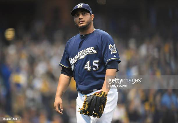 Starting pitcher Jhoulys Chacin of the Milwaukee Brewers reacts after the third out in the first inning of Game Two of the National League Division...