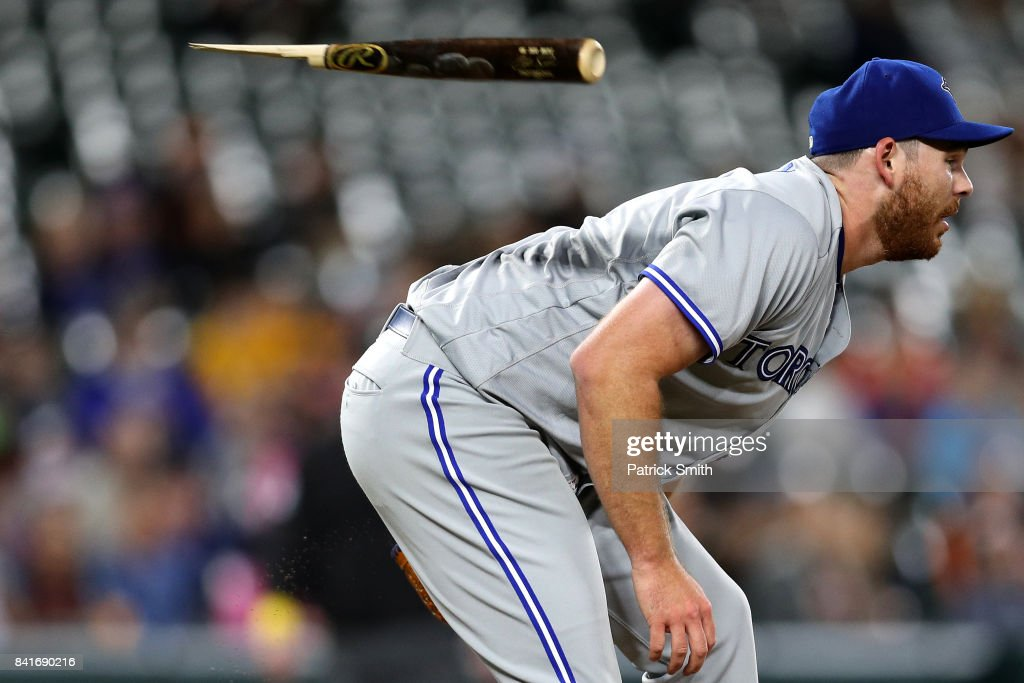 Starting pitcher Joe Biagini #31 of the Toronto Blue Jays ducks before being hit with the shattered bat of Chris Davis #19 of the Baltimore Orioles (not pictured) during the third inning at Oriole Park at Camden Yards on September 1, 2017 in Baltimore, Maryland.