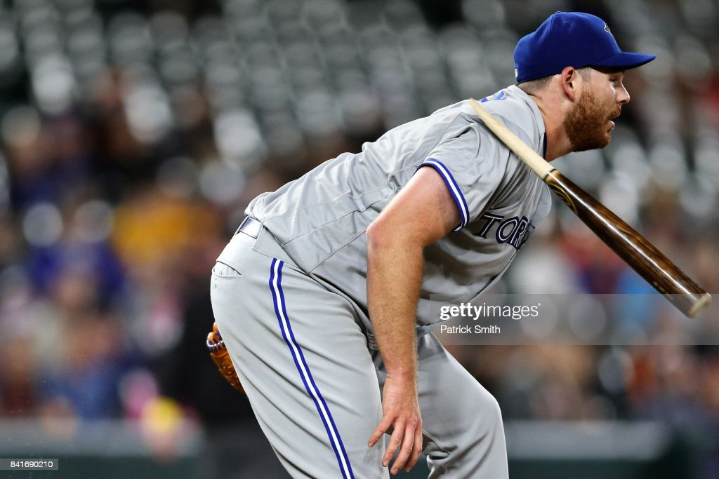 Starting pitcher Joe Biagini #31 of the Toronto Blue Jays is hit with the shattered bat of Chris Davis #19 of the Baltimore Orioles (not pictured) during the third inning at Oriole Park at Camden Yards on September 1, 2017 in Baltimore, Maryland.