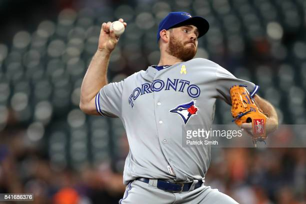 Starting pitcher Joe Biagini of the Toronto Blue Jays works the first inning against the Baltimore Orioles Oriole Park at Camden Yards on September 1...