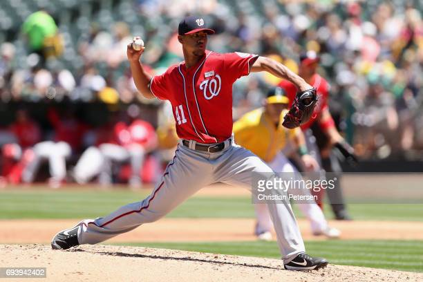 Starting pitcher Joe Ross of the Washington Nationals pitches against the Oakland Athletics during the MLB game at Oakland Coliseum on June 3 2017 in...