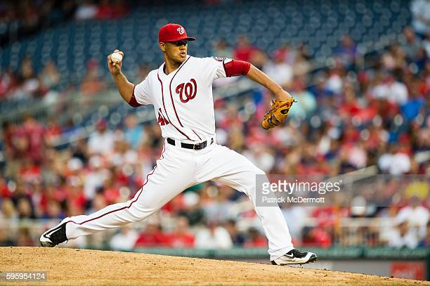 Starting pitcher Joe Ross of the Washington Nationals throws a pitch to a New York Mets batter in the second inning during a MLB baseball game at...