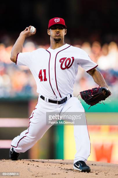 Starting pitcher Joe Ross of the Washington Nationals throws a pitch to a Baltimore Orioles batter in the first inning during a game at Nationals...