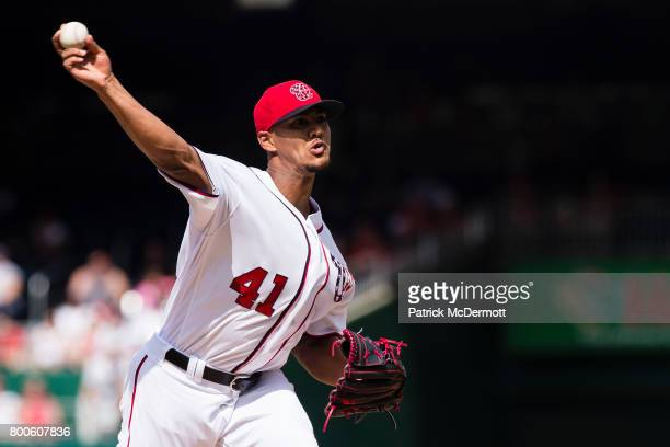 Starting pitcher Joe Ross of the Washington Nationals throws a pitch to a Cincinnati Reds batter in the first inning during a game at Nationals Park...