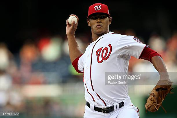 Starting pitcher Joe Ross of the Washington Nationals works the first inning against the Pittsburgh Pirates at Nationals Park on June 19 2015 in...